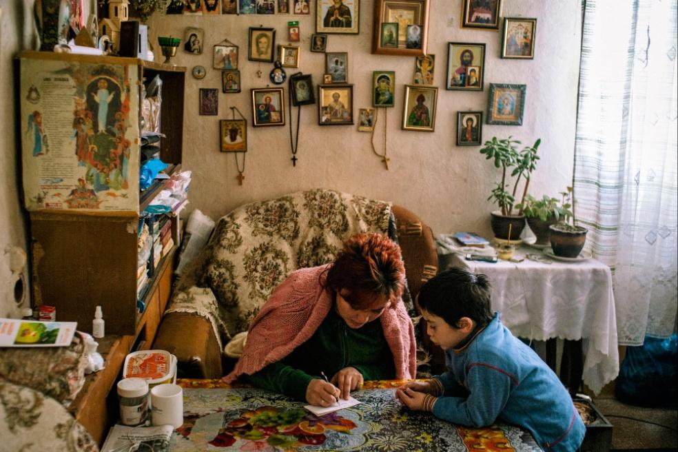 Art and Documentary Photography - Loading 03.Hatuna-Kviria-with-Takha-write-a-goods-list-they-shall-buy-for-a-week..jpg