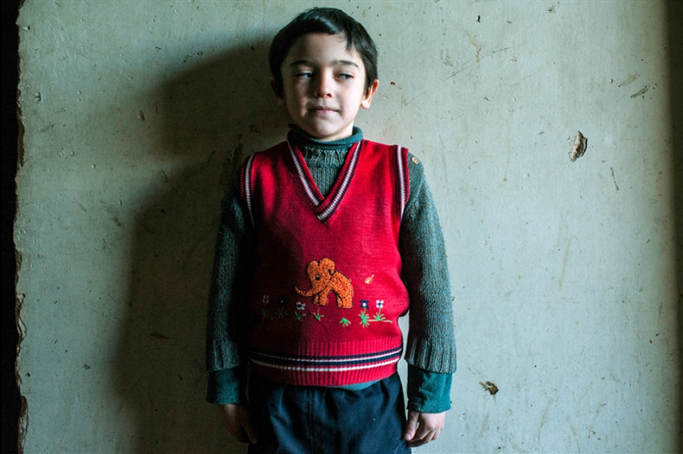 Art and Documentary Photography - Loading 25.Takha.7y.o.lives.with.his.mother.and.loves.drawing.on.the.walls.jpg