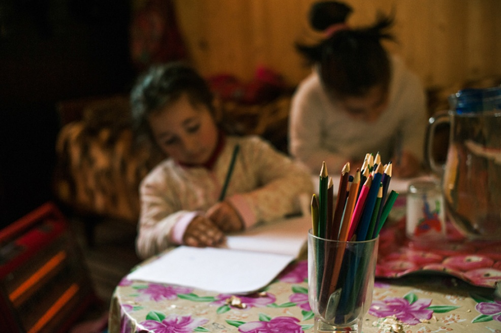 Art and Documentary Photography - Loading 26.Sisters.Nuki.Anna.sit.on.the.floor.by.the.heater.drawing.with.colored.pencil.jpg
