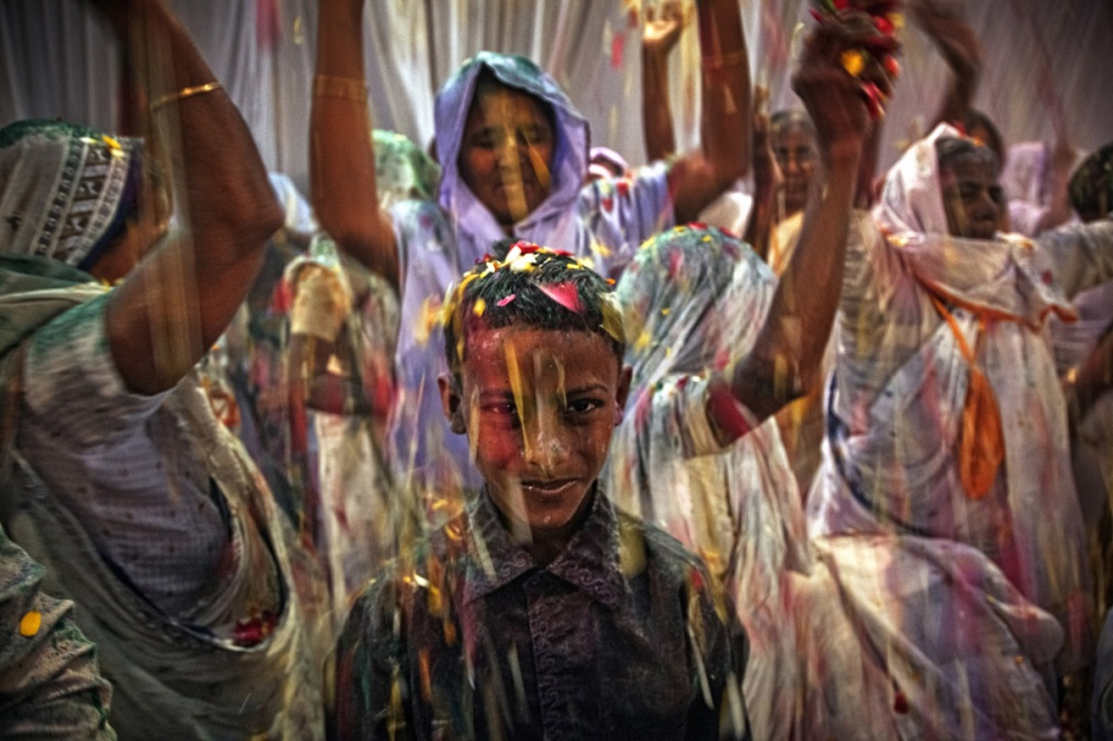 A kid takes part at the Holi celebration at Meera Sahabgini ashram