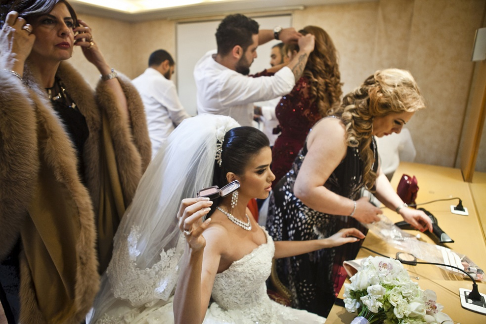 BEIRUT, LEBANON Jessica Obeid and her female relatives fix their make up in her holding room before she enters her large wedding. Her mother, Leila Obeid, is a famous beauty consultant featured on National television.
