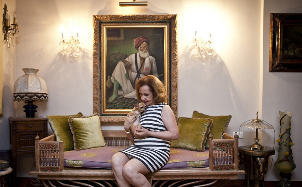 BEIRUT, LEBANON Salwa Choukheir, who sponsors the Debutante Ball, and finances various charities, with her Chihuahua dog in her living room at her home in Beirut, Lebanon.
