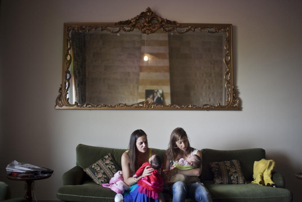 HAMMANA, LEBANON Ghina Arslan (L), her friend, with their new baby daughters in Ghina's husband's mountain home in Hammana, Lebanon. Following Lebanese tradition, Ghina welcomes her baby Karma with a baby shower after Karma is born, where family and friends attend a brunch.