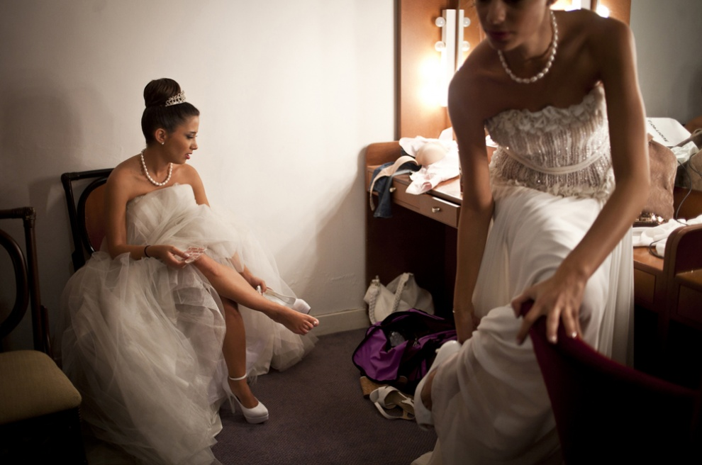 JOUNIEH, LEBANON Dima Arabi, the oldest Debutante participant, 24, after her hair and make up has been applied, puts her dancing shoes on in the communal dressing room, before the Ball.