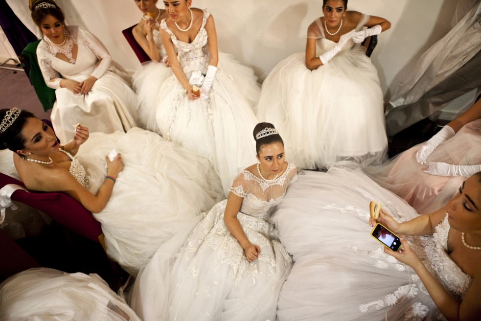 JOUNIEH, LEBANON Debutante participants have a snack backstage in the dressing room before the Ball.