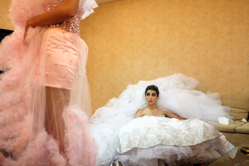 BEIRUT, LEBANON Sara, 22, who graduated five days before her wedding, waits in a holding room before she makes her entrance to her 650- guest wedding in BIEL Center, Beirut, Lebanon. Her dress weighs 15 kilos.