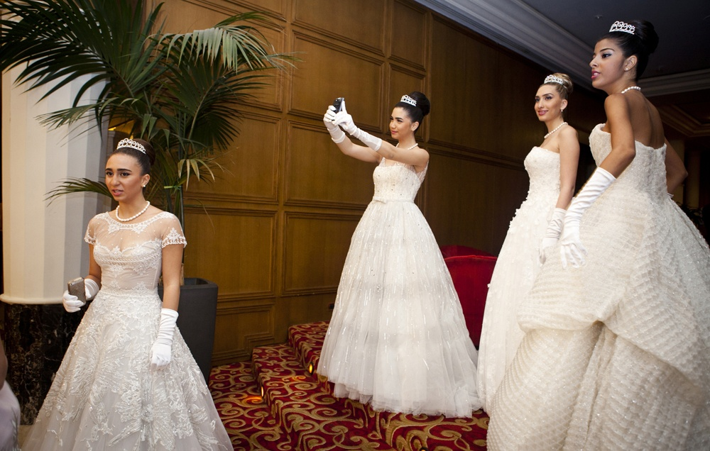JOUNIEH, LEBANON Taline Mansour, (center) poses for a self portait on her mobile phone, while amongst Debutante Ball participants, before the Ball at Casino du Liban where the Ball is held.