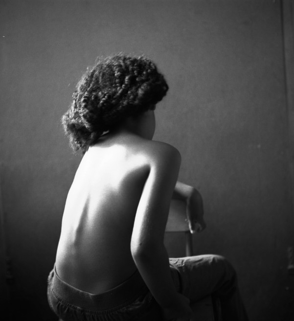 Art and Documentary Photography - Loading back of young girl.jpg