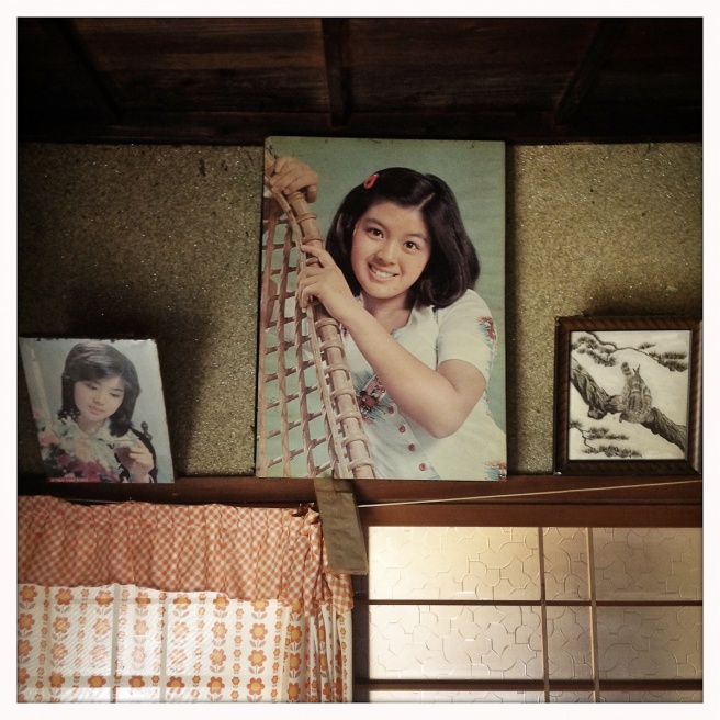 An old picture of a 70's teen idol remains hanging on the wall of an abandoned house owned by Eiko Nakano, 86, who lives in a nearby group home called Kouyou-no-Sato, which means fall foliage.