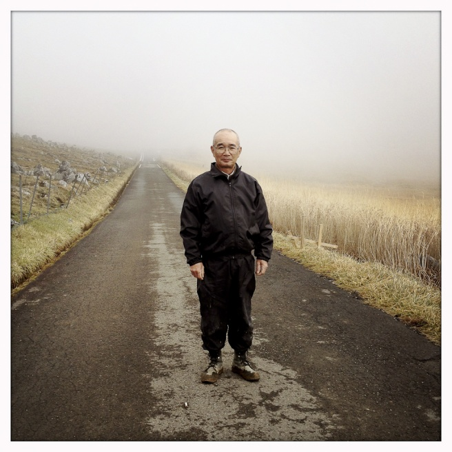 Taniwaki Susumu, 54, a local road worker who secures the surrounding mountain roads, stands for a portrait.