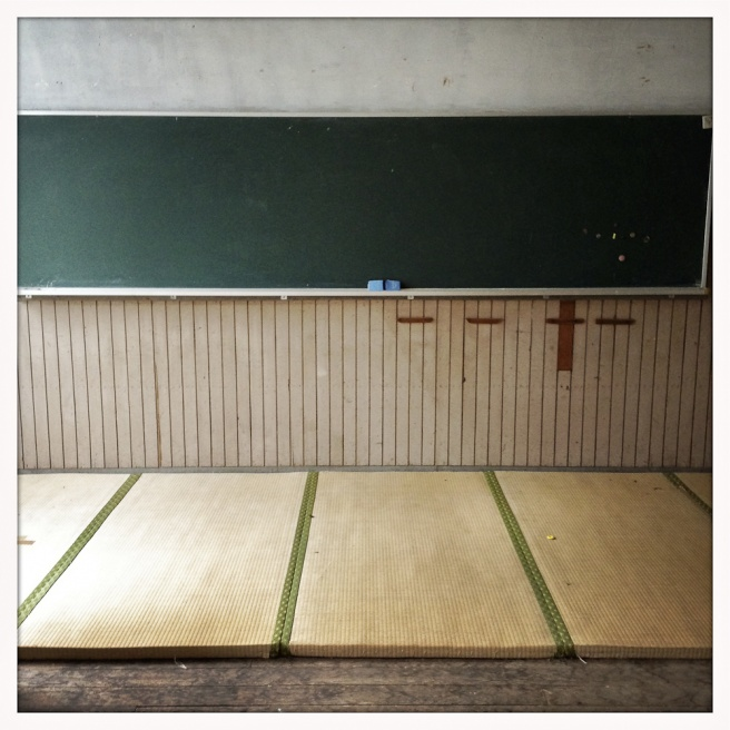 Tatami mattes remain in an empty class room at Oda - Miyama elementary, which has been abandoned since 2003.