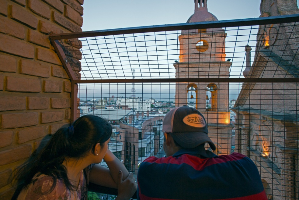 Teenagers looking at the city of Santa Cruz.