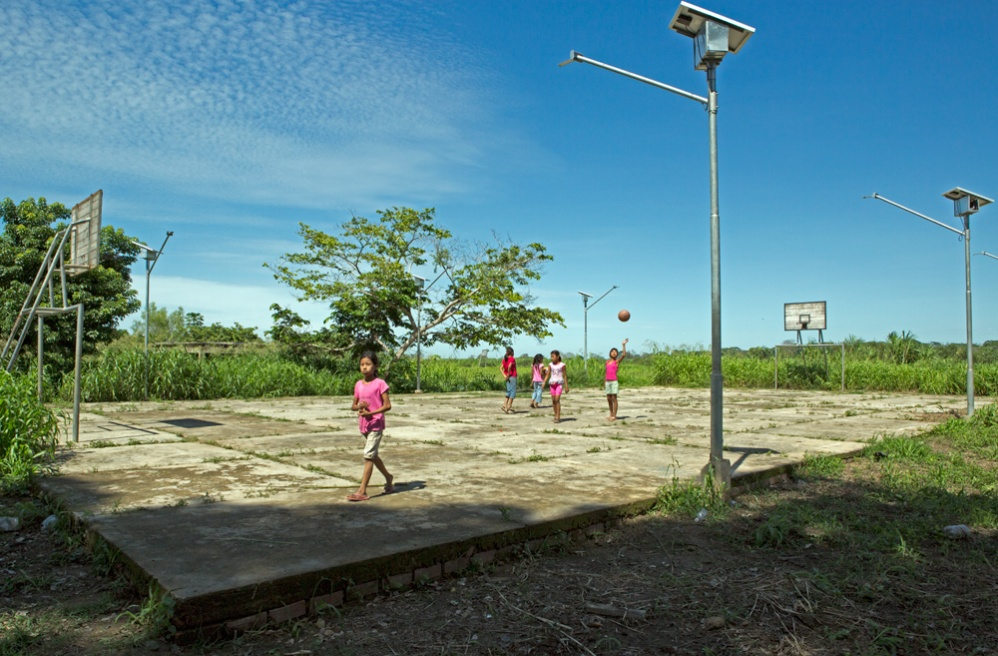 Solar powered houses and a basketball field were built near the ongoing project in Mangalito.