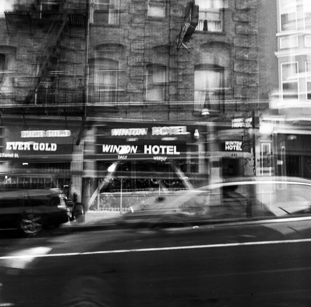 A DOUBLE-EXPOSURE of the Winton Hotel, an SRO (single-room occupancy) lodging in San Francisco's Tenderloin neighborhood. The neighborhood has seen an increase in isolated, poor elderly and chronically ill residents who are aging in place. The caustic environment of these hotels lead many elderly and sick residents' conditions to worsen and they are in and out of the hospital without support to bridge the gap between. San Francisco has begun a pilot program called the Homecoming Transitional Care Program with to respond to the needs of these residents and have seen a drop in hospital recidivism and an increase in self-advocacy, saving money for the City and empowering lives.
