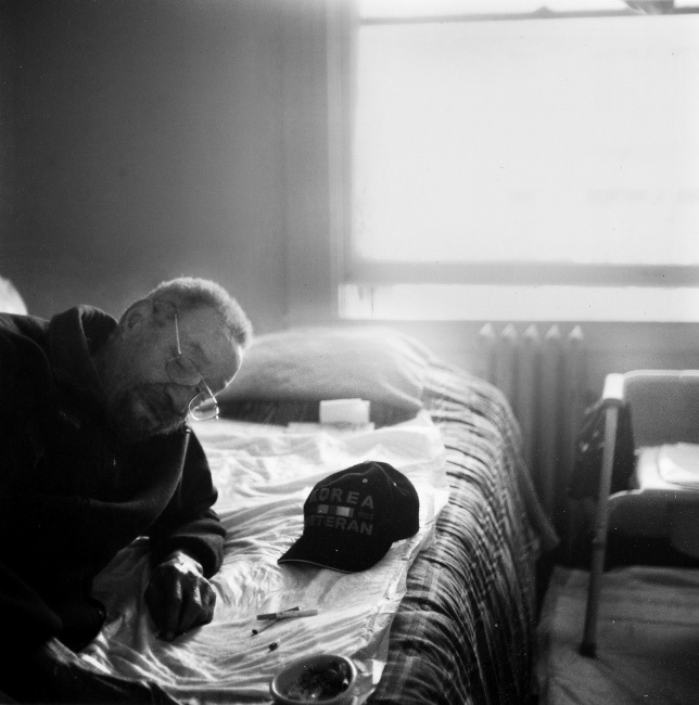 Harold Barber, a 80-year-old Korean War veteran, in his room at the Winton Hotel in San Francisco's Tenderloin District.