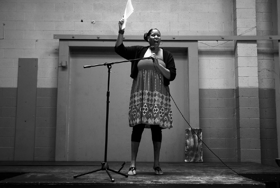 "Lakeisha Burton, a spoken word artist and poet, performs a piece at Chuco Justice Center. ""It's a way to own my story,"" she says."