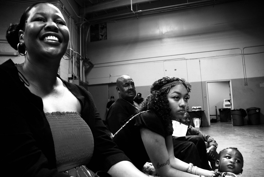 LaKeisha watches a youth group perform at Chuco's Justice Center in Los Angeles, California. With her infectious optimism and self-determination, LaKeisha Burton displays almost nothing of her past; she lives, works and dates, as any women like her. Yet, these things are exceptional for someone who had lost, some might say had stolen, nearly two decades of the most developmental period in one's life and with very little preparation thrust out into society. Ms. Burton says when she was released it was as if she were still 15 going on 16.