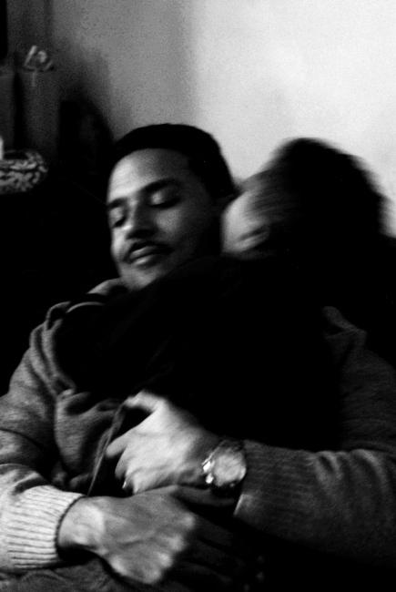 Fernando, Jr. spontaneously embraces his father.