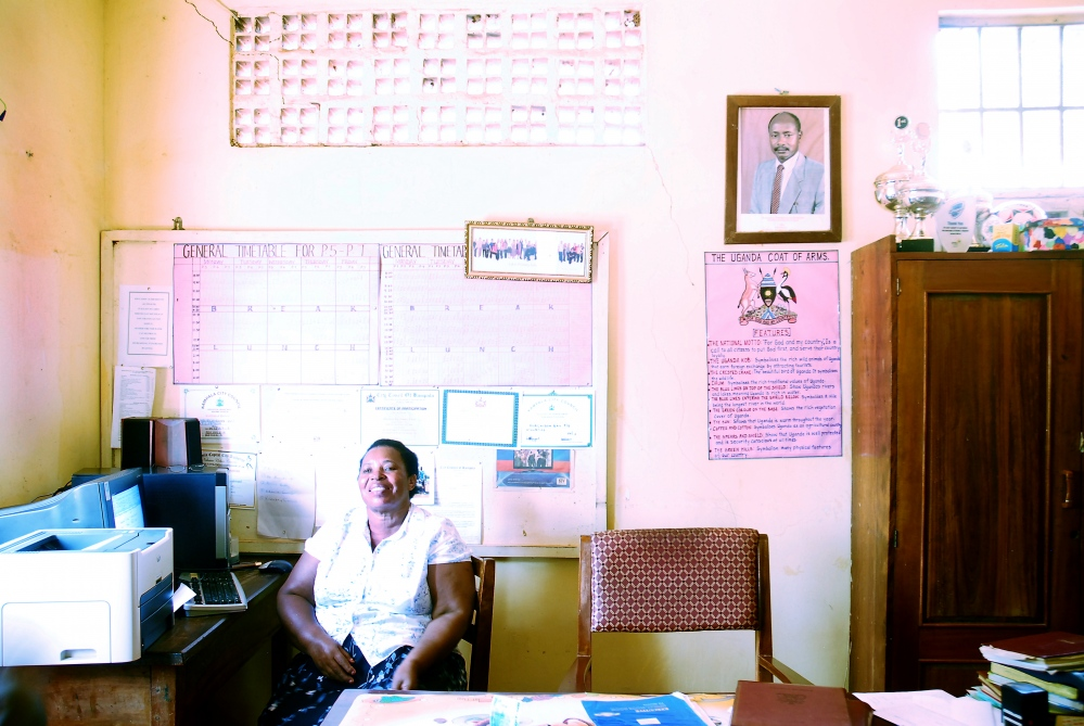 Miriam, the headmaster of Murchison Bay Primary School. The school and library, which opened in 2012, are situated within the Luzira Prison compound where many of the prison staff live with their family.
