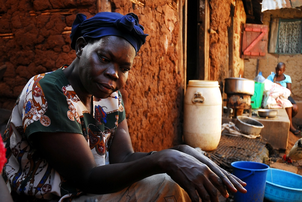 Alice, a home brew gin maker, stands in front of her home in a slum outside Kampala. Uganda, despite relative stability and economic growth in recent years, remains one of the poorest and least developed countries in the world.