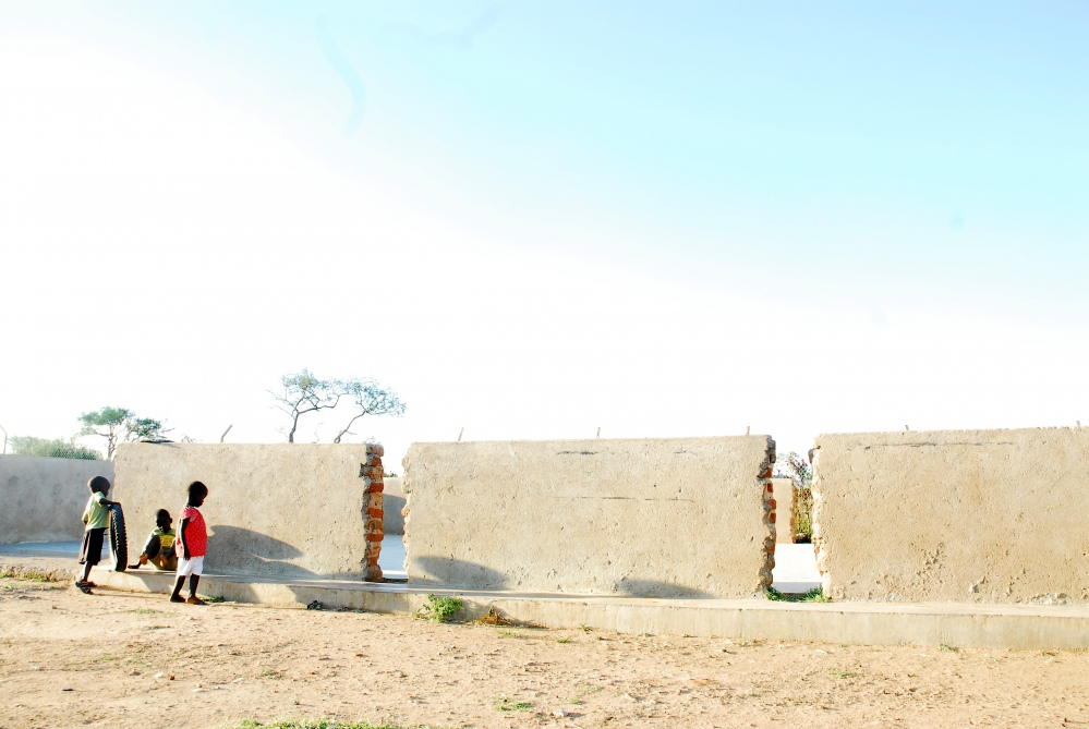 Children play at local home for street children in Kotido. The home was later assessed for its child welfare and found to be acting as a business rather than a safe house - children were not in school, children with disabilities were without proper assistance and the children's status as orphaned or not were unclear.