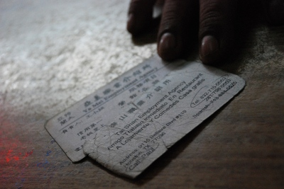 An undocumented Mexican immigrant shows the business cards of the Chinese employment agencies that smuggled him from the U.S.-Mexico border to New York City.
