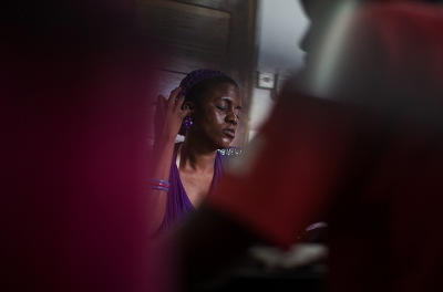 Grace Mbawala, 27, dozes off at a Medicins du Monde training for heroin addicts in Temeke, Dar Es Salaam, Tanzania. Mbawala is addicted to heroin, cheap in Dar Es Salaam because Tanzania's harbors are a main port of entrance for drugs from Pakistan and Afganistan on the way to Europe.