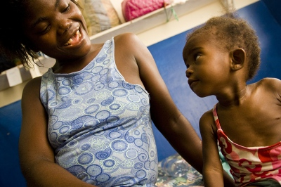 A mother and her daughter smile at each other in a hospital for malnourished children in Monrovia, Liberia.