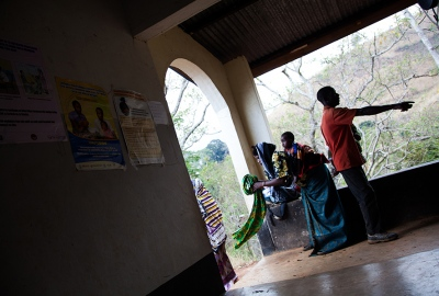 A family prepares to leave the Towero Clinic in the Morogoro region of Tanzania. They come for regular check-ups on the weight of their baby.