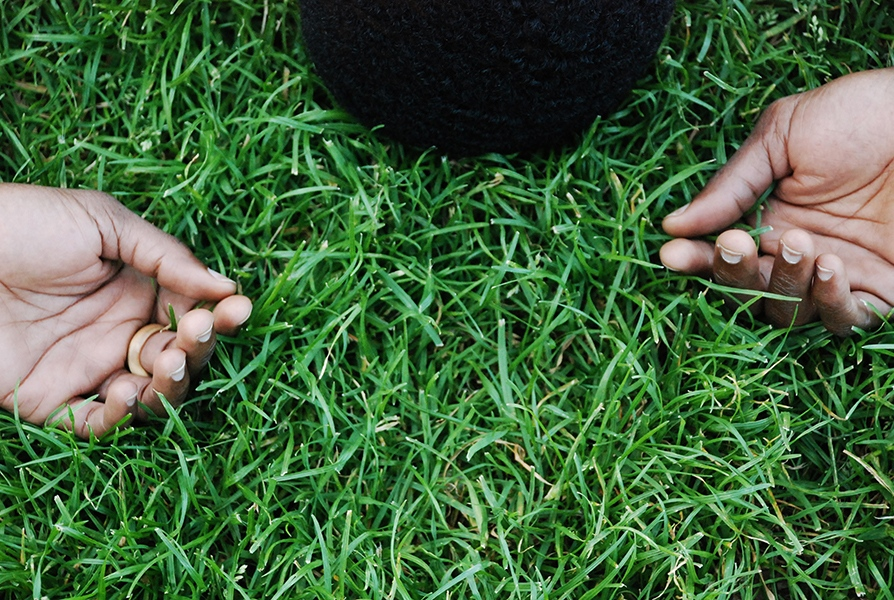 Kwesi Okyere, an immigrant from Ghana applying for asylum in the U.S., lies in the grass at Central Park, NY, days after being released from an immigration detention center.