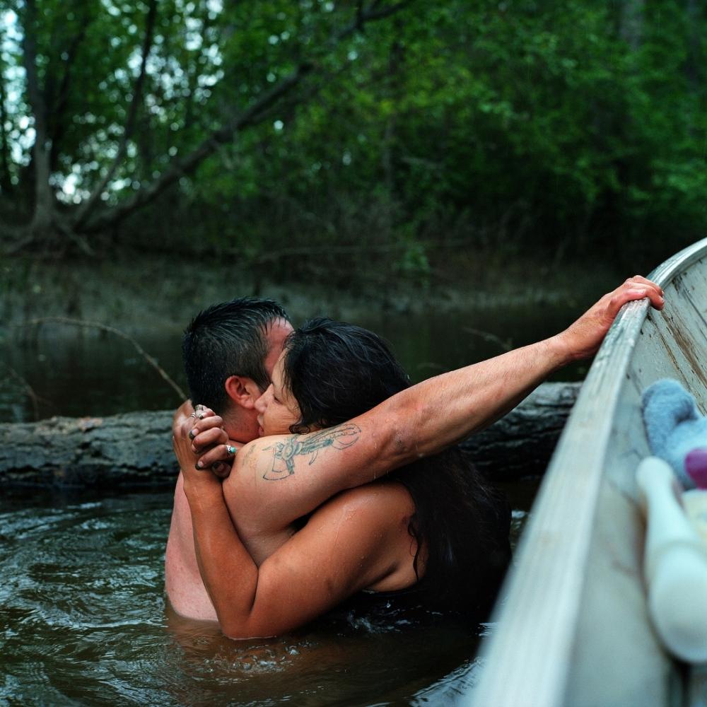 July 2013- Mark John L'Hommecourt embraces Amanda Grandjambe while bathing in a creek off of the Athabasca River near the Poplar Point Reserve.