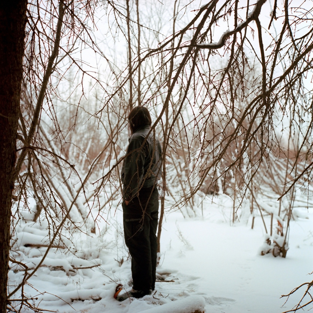 December 2011- Gabe Desjarlais looks at a beaver dam on the L'Hommecourt trapline. Traplines are partitions of land allocated to individuals and passed down through families for hunting and trapping. Many of them have been taken over by industrial development. Fixated on his grandfathers lesson of respecting the land, Gabe steadfastly refuses to work for industry and but makes an income doing odd jobs for the Band.
