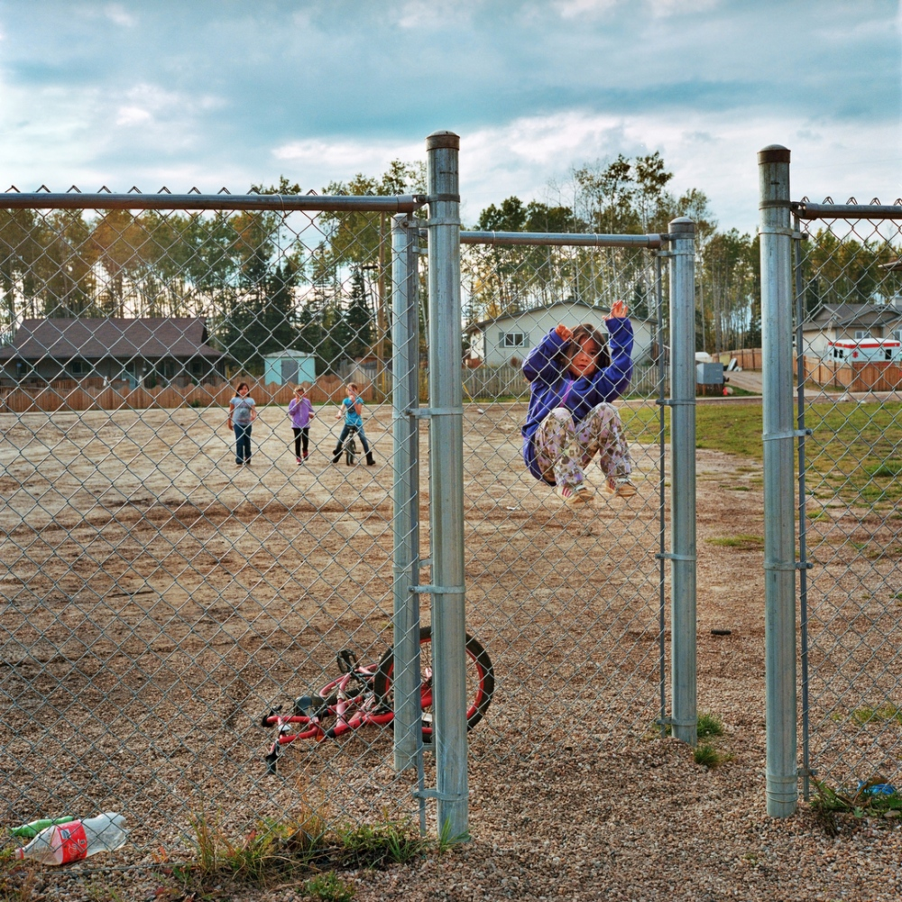 September 2013- Children play at a playground in Fort McKay First Nation.