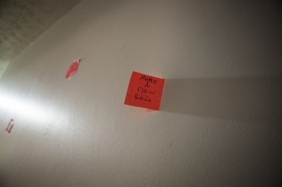 "A post-it in the living room of Melanie Dillon, 34, a sex trafficking survivor in Columbus, Ohio, reads ""Make a new future"". Melanie's daughter, Ariel Pace, 10, wrote post-its and put them around their home to encourage her mother as she recovered from heroin addiction and sex trafficking."