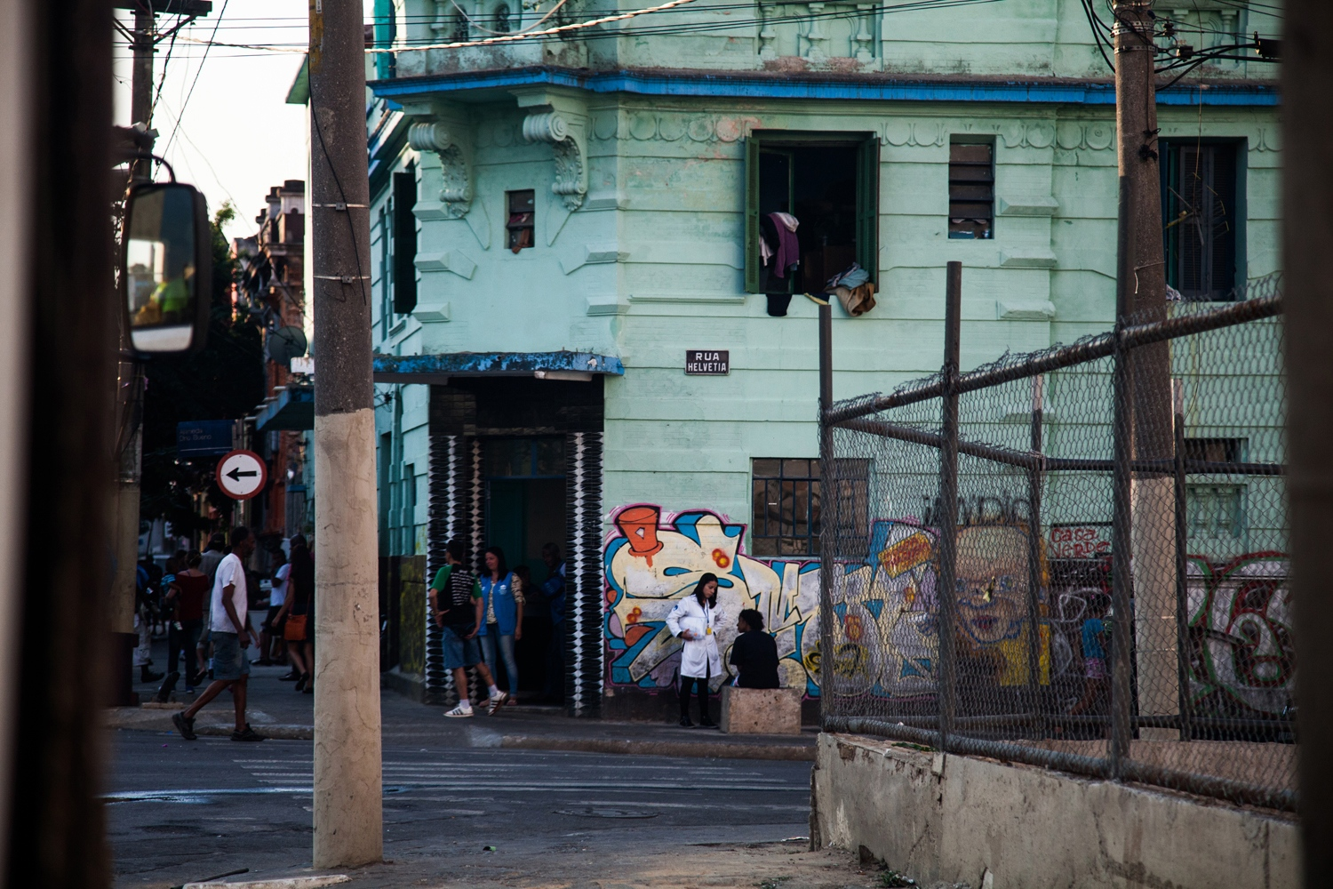 Health workers talk to addicts outside one of the eight De Braços Abertos hotels. The program has over 400 participants and there are plans to expand it to more.