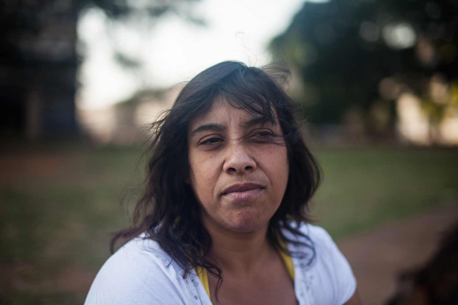 "Patricia Alves, an addict part of the De Braços Abertos program, was a photographer working at a commercial center before she ended up in Cracôlandia seven years ago. She did so after falling in love with a man who was addicted to crack. Her daughter disappeared one day while they were sleeping in the street. She sees having her own room like a luxury she's thankful for. ""De Braços Abertos trusted us. It gave us an opportunity, which many didn't do,"" she said."