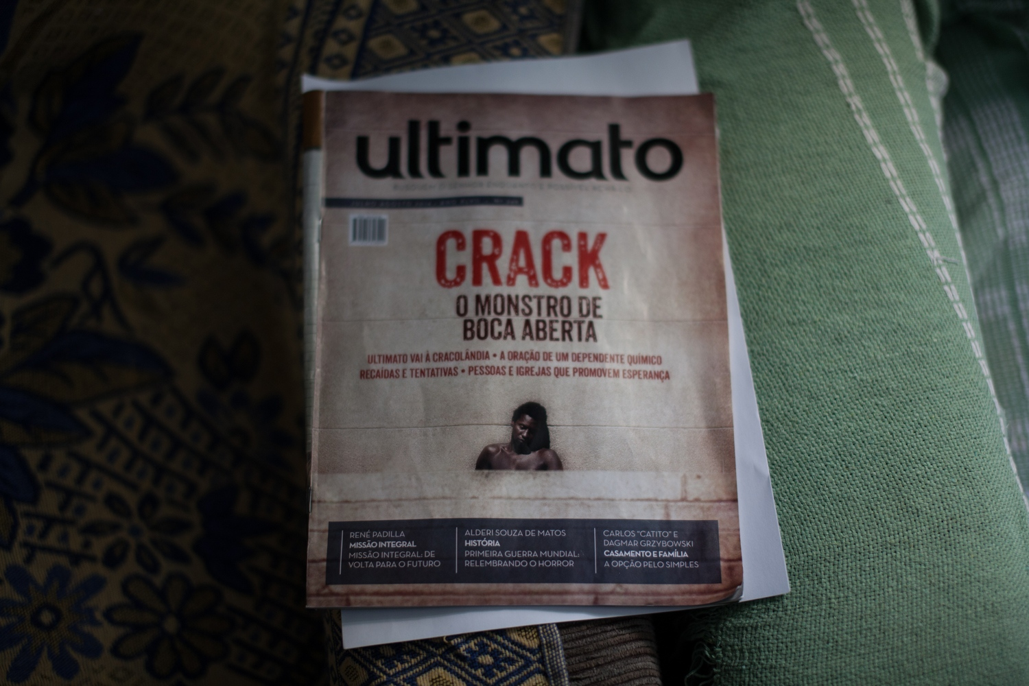 "A magazine whose cover story reads ""Crack: the open-mouthed monster"" sits in the living room of Nildes Nery, a female pastor who works with crack addicts in Cracôlandia. ""Throughout all these years I've been here, I've seen many things, deaths, fights,"" said Nery. ""Cracôlandia is like that, a hard place. A hard place to work, to live, to relate. But I say that in the middle of the crack rocks, I can find also precious gems."""