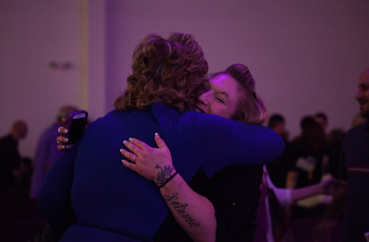 Jennifer Kempton, 32, hugs a fellow parishioner at church on Sunday morning after Jennifer gave a speech about leaving prostitution and finding God. Jennifer says church and community really help her heal. She's working hard to reunite with her children.