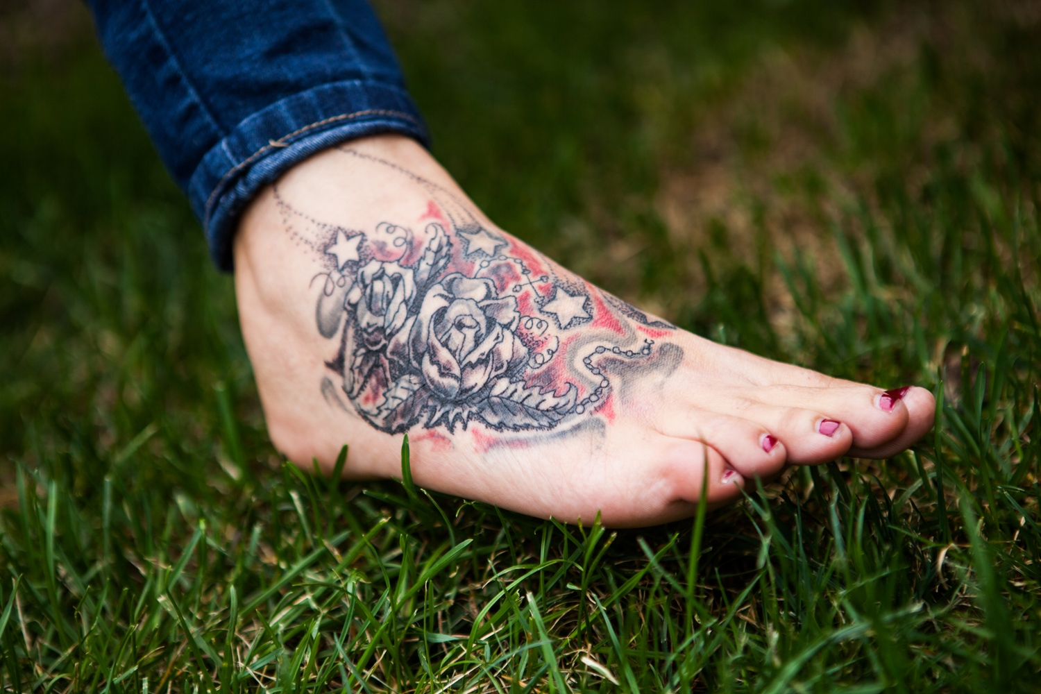 "Christina Brooks, 29, had the name of her ex-husband and trafficker tattooed on her foot. He tattooed it himself on her. Three days ago, recovering from heroin addiction and on track to getting her life back together, Christina had her tattoo covered up by artwork thanks to a Survivors Ink scholarship Lancaster, Ohio, USA. ""I feel like as long as I had his name on my foot he had a claim on me. I've felt so dead inside, but now it's like a new chapter is starting,"" she says. ""It's just overwhelming, all of this. That I get to choose what goes on my body this time. That it's finally over."" Her divorce papers were approved recently and she reunited with her two baby girls."