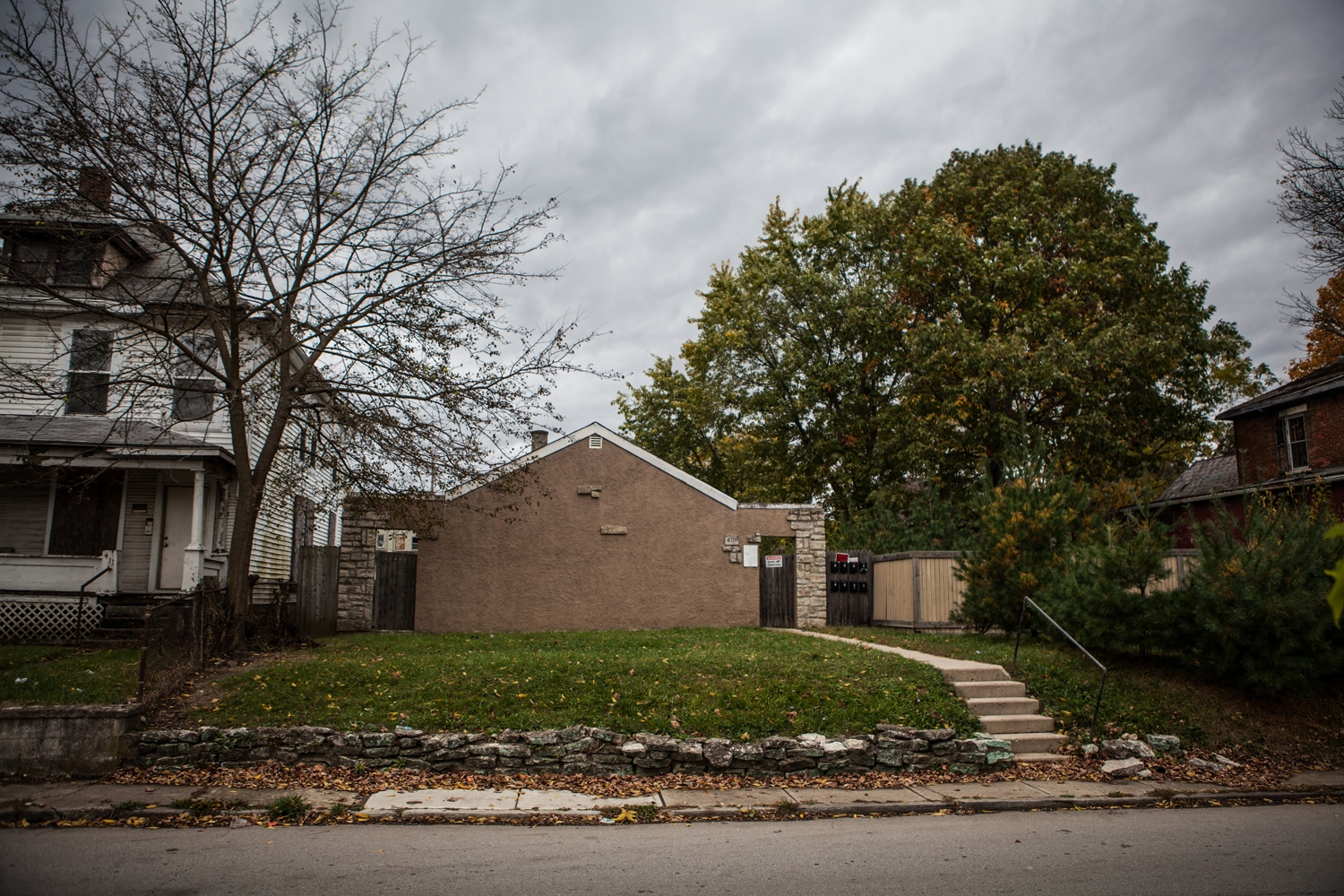"A house on Ryan Street in The Bottoms neighborhood of Columbus, Ohio, where Jennifer Kempton, 32, was trafficked for over a year in 2009 and 2010. ""Living there was horrible. The apartments were rented out to dope boys and I was expected to make money to supply our addiction from those dope boys being pregnant and all,"" Jennifer said. ""My memories of that place are of misery and horror"".  Jennifer now comes about once a month to The Bottoms to do outreach, talk to women, give them hygiene bags and let them know that there is help."