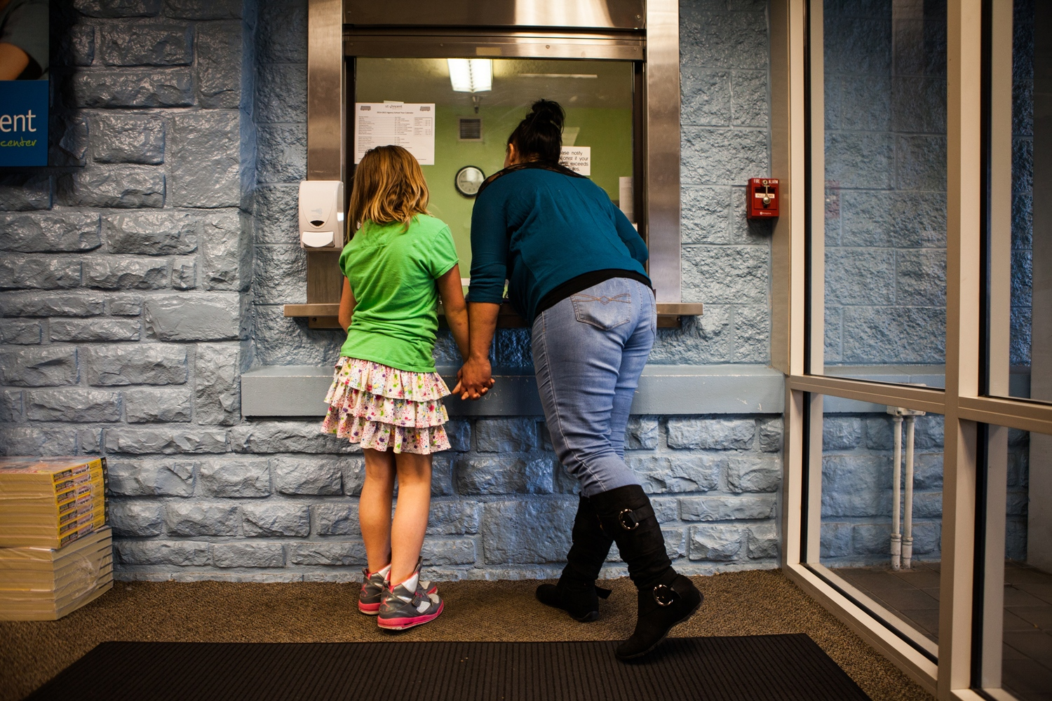 Melanie Dillon, 34, and Ariel Pace, 10, talk to the receptionist at Ariel's special education school in Columbus, Ohio. Ariel is bipolar like her mother, a sex trafficking survivor. While Melanie was battling with heroin addiction and being trafficked, Ariel often performed like a mother, Melanie said. She would undress her, clean her and put her to bed.