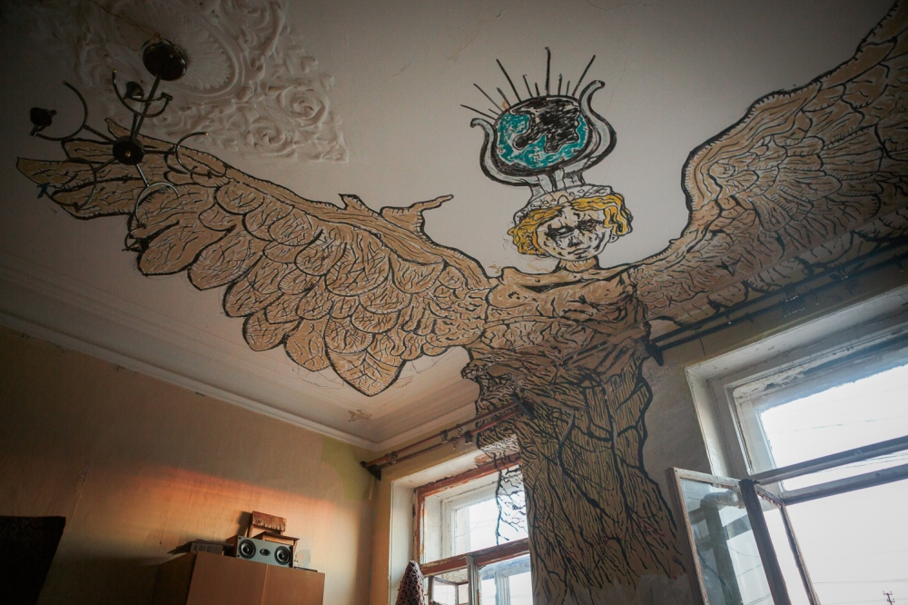 """Nika holds us in her wings,"" writes Sasha who painted ""Nika"" the angel on his apartment ceiling."