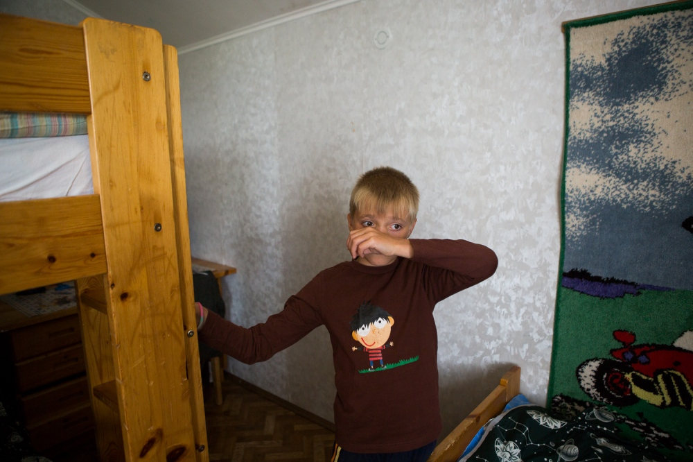 Roman, age 10, in his bedroom.