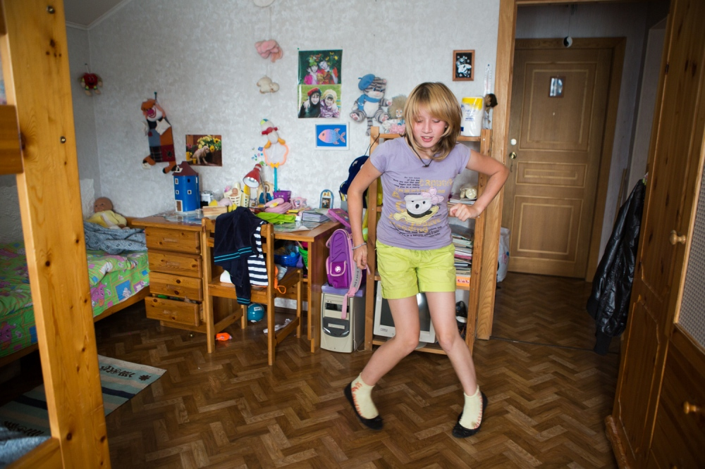 Antonina, age 12, dances in her bedroom. Dancing is one of her favorite hobbies that she picked up from summer camp.