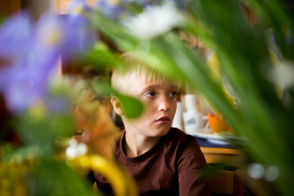 Roman, age 10, sits at the Patoka family kitchen table. Roman moved to the village with his older brother Denis, 12, when he was 7 years-old.