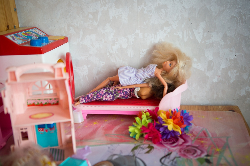Barbie dolls wait to be played with inside the girls bedroom.