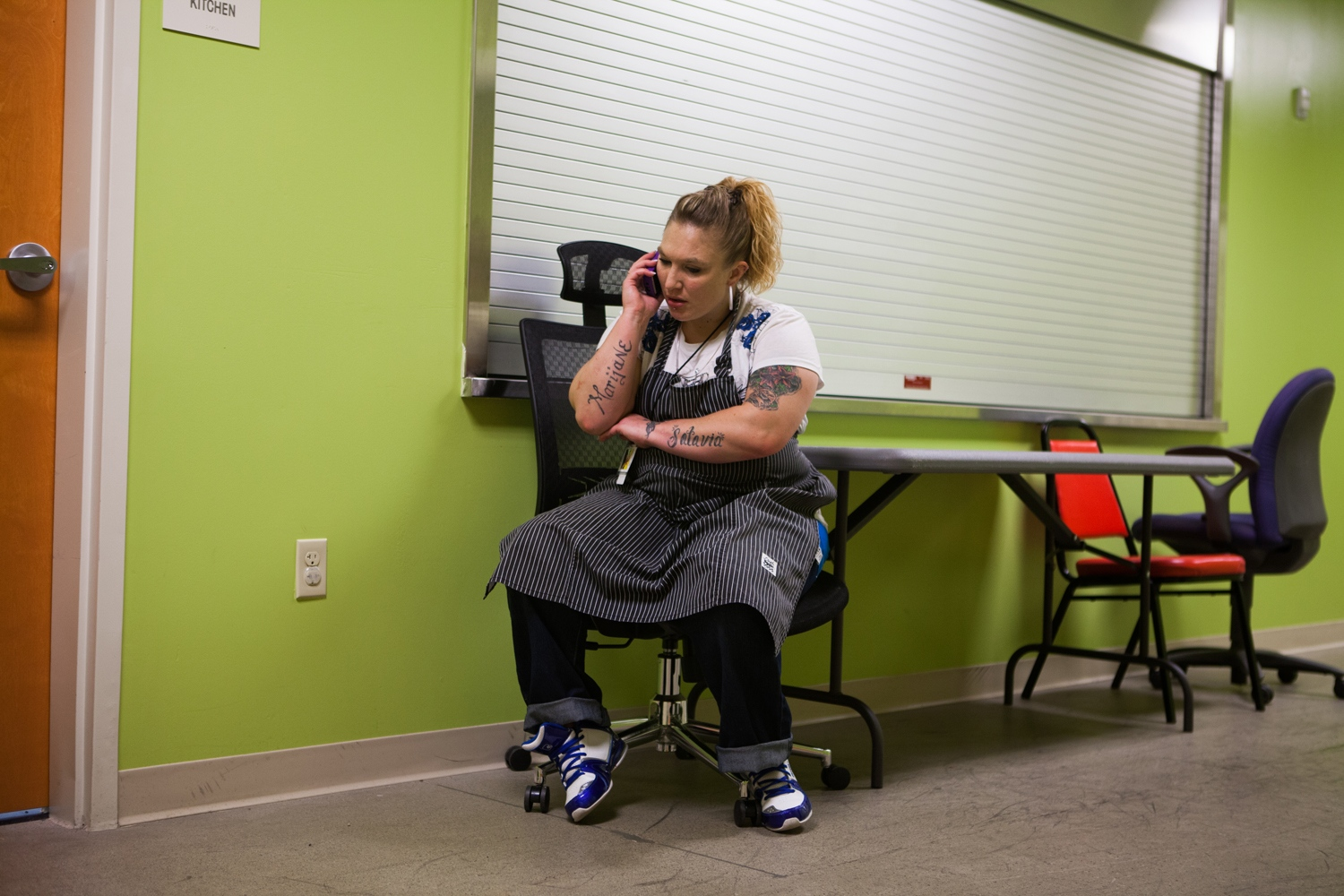 "Jennifer Kempton, 32, takes a break to make a phone call at Freedom a la Cart, a catering service company where she works that employs sex trafficking survivors in Columbus, Ohio, USA. ""There is this stereotype that we're a success if we have a minimum-wage job and we can stay clean,"" she says. To her this isn't acceptable. ""We can live way above that. Trafficking survivors have faced evil and conquered it. We have lived on the streets and survived the worst of the worst. We have had demons attack us, beat us, rape us. We are some of the strongest women in the world, and we can go above and beyond what other people can do. You're not going to box me up – no way, I'm sorry but no. I'm here to stay."""