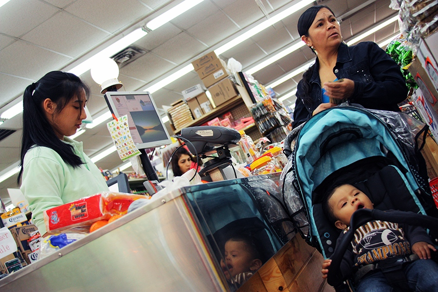 Rosa (name changed to protect anonymity), an undocumented Ecuadorean immigran, buys groceries with her son at a Queens, NY, supermarket. Rosa is in deportation proceedings despite being a domestic violence survivor and having a U.S. citizen son.