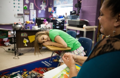 Melanie Dillon, 34, and Ariel Pace, 10, play at Ariel's special education school in Columbus, Ohio. Ariel is bipolar like her mother, a sex trafficking survivor. While Melanie was battling with heroin addiction and being trafficked, Ariel often performed like a mother, Melanie said. She would undress her, clean her and put her to bed.
