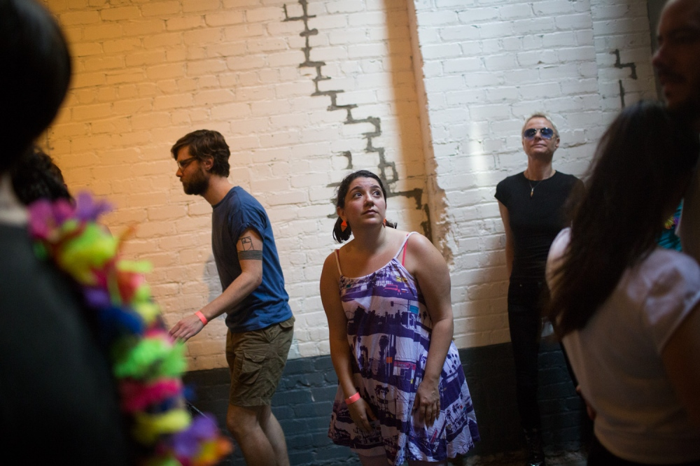 Sherri Kornfeld, center, dances at the morning rave. At 94 Wythe Ave., Morning Gloryville NYC hosts its first morning rave from 6:30 to 10am on Wednesday, May 7, 2014.